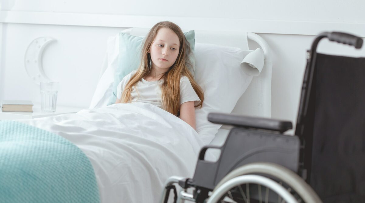 Disabled girl and a wheelchair
